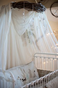 love the tulle draped over the twig wreath and crystals. not the jesus pillow though