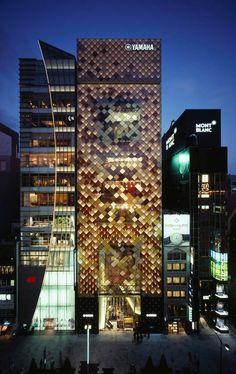 Yamaha Ginza: curtain wall innovation, laminated glass panels, diagonal cable grid.
