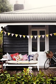 black exterior with white trim, wood flooring My dream cottage colours Interior Exterior, Exterior Colors, Exterior Paint, Black Exterior, Interior Design, Interior Decorating, Outdoor Spaces, Outdoor Living, Outdoor Couch