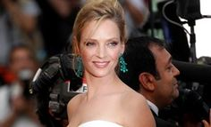 Uma Thurman in Chopard emerald chandelier earrings and bracelet at Cannes Film Festival 2011. The earrings sparkle with 34 pear-shaped emeralds.  Holy moly!