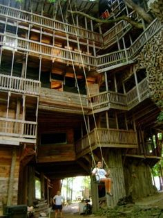 Minister's House in Crossville, Tennessee.  The world's tallest treehouse, It measures over 97 feet tall and uses 6 Oak trees as pillars to support the structure.