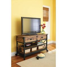 """Rustic Country Antiqued Black/pine Panel Tv Stand for Tvs up to 52"""". Accommodates most 52"""" flat panel TV's up to 95 lb Rustic details lend the charm of a well-loved antique. 2 spacious shelves for storage or display Black TV Stand features 2 drawers for storing media components. Textured metal legs and fixed wheels Back panel keeps wires hidden. Engineered wood with a laminate finish Assembly required. Better Homes and Gardens Rustic Pine TV Stand for TVs up to 52""""overall dimensions:..."""