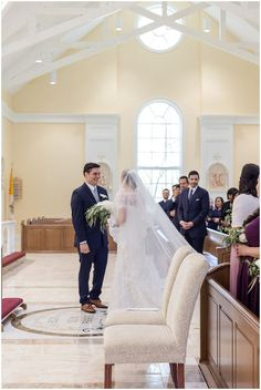 A Loudoun County wedding in spring with a Catholic mass at St. Frances DeSales and reception at River Creek Club. Photography by Erin Julius of Imagery by Erin.