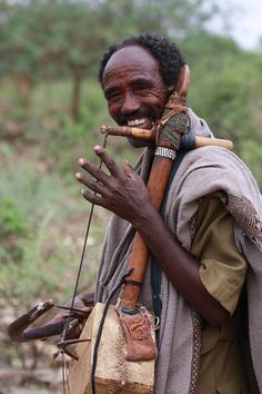 Ethiopian man playing a masinko; A Tigrian man playing a traditional instrument We Are The World, My People, People Around The World, Ethiopian People, Ethiopian Music, African Life, African Culture, African Art, African Tribes
