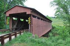 Sarvis Fork Covered Bridge, also known as Sandyville Covered Bridge, is a…