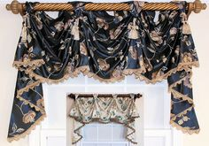 Embroidered flowers on faux-silk are perfectly united with lavish trim to create the ultimate backdrop for the Bonita Victory Swag in Navy or Oyster. Visit www.rlfhome.com for more exciting choices!