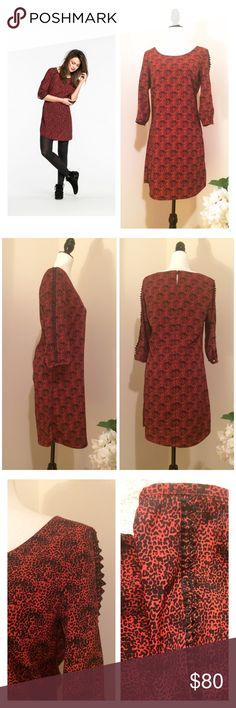 """EUC Maison Scotch red animal print dress Barely worn, this dress has no signs of wear whatsoever. It's very girly, and you can wear it with sneakers or booties. The fabric is light and feels silky (100% polyester), round collar, back 2 button closure, 3/4 sleeves with cut embroidery detail. Aprox measurements: 34"""" long, flat across: waist 18"""", armpit to armpit 19"""". Sleeves are about 18"""" long. Size 2. The stock picture is very similar but not exactly the same dress. The fit is about the same…"""