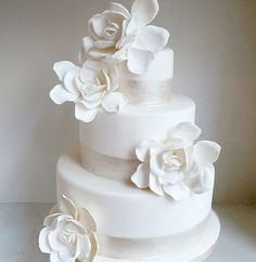 White fondant cake with magnolias and organza opalescent ribbon by K. Rose Cakes