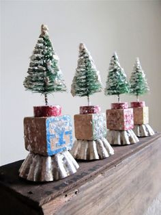 Christmas Trees made with vintage finds - including wooden alphabet block, bottle brush tree, tart tin and embellished with mica flakes.