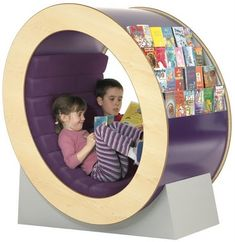 Very cute and cozy. A children's unit for public libraries, schools and children's centres across the UK. Children can take a book from the display on each end of the unit and then curl up inside and read it. From Opening the Book Furniture