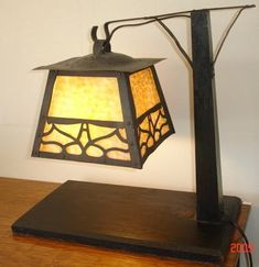 Arts and Crafts Pagoda Lamp, Gustav Stickley.   Excellent copper cut-out work overlaying original slag glass. Supported by a substantial Oak base and arm with copper arms