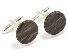 Handmade Wood Cufflinks for Men, crafted in Maryland with Bocote wood. These cufflinks are the perfect gift for him, and will add a splash of nature to any outfit. http://www.handmadeformen.com/collections/wood-cufflinks/products/square-wood-cufflinks-walnut
