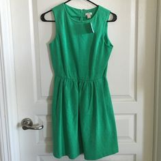 NWT J Crew Factory Green Dress Size XS Cute and comfy dress for spring and summer. Material is a thick stretchy cotton that feels similar to a sweatshirt. Dress also has a zip up back, pockets and ends above the knee. Color is a faded emerald green (see last pic). No trades or Paypal. J.Crew Factory Dresses Mini