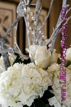 centerpieces with flowers, branches, jewels
