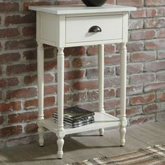 You can add a touch of vintage charm to your living room with the Signature Design by Ashley Juinville Accent Table. This table features a painted wooden frame with turned legs, and its drawer and lower shelf are perfect for organizing small items. Low Shelves, Shelf, Nebraska Furniture Mart, Ashley Furniture Industries, Signature Design, Classic White, Drawer Fronts, Small Spaces, Wooden Frames