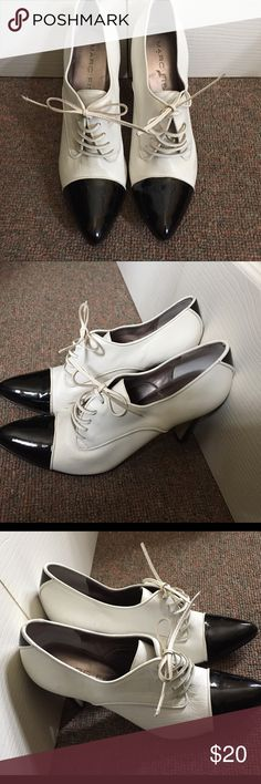Marc Fischer white lace up pointed toe heels Black and white contrast color heels are made from faux leather with a patent leather toe and stripe in back. Heel height is about 3.5in. Steep incline coupled with vintage-esque lace up closure gives it a sophisticated yet off-beat feel. Pre-owned but in great condition except for minimal signs of wear from scuff marks pictured. Marc Fisher Shoes Heels