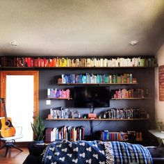 """I finished my bookshelves. I made them out of 1/2"""" plumbing pieces and some lightly stained wood with my amazing Mom, @tooltime33 who as usual went above and beyond the call of duty helping me get them done and helping me get the books in an order that made my eyes happy. Thank you Marmie. So much. Also, I spy a rad @cozycourage blanket by @headregal too. What a wonderful charity to support. Do so, if you aren't already. Hope you like the shelves!"""