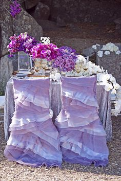 The floral colors..the Ruffle chair covers...so pretty (this would be super cute to do for the Bride at her shower or the Bride and Bridesmaids if you don't have like 14)