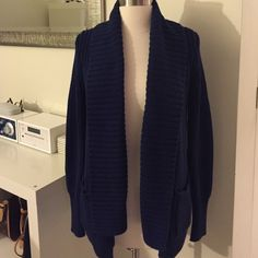 Jcrew Cardigan Jcrew shawl cardigan in dark blue. Never been worn with tags attached. Material is cotton. Falls past the hips with pockets on the front. Woman's extra small. J. Crew Sweaters Cardigans