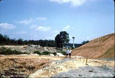 Interstate 64 construction at Staples Mill in August 1965. Water tower possibly Crump Company, later GE, then AT&T, then torn down. Location of water tower is now Comcast. [permission granted by Jeff Hawkins]