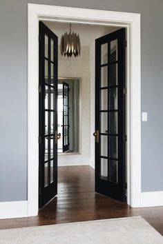 Inverway — jean stoffer design JSD Jean Stoffer Design- Black french doors and white skirting board and moulding around Blue Walls, Door Design, Black Interior Doors, Black French Doors, Grey Walls White Trim, Home, White Doors, Doors Interior, Blue Painted Walls
