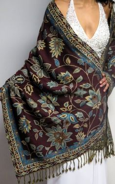 women love to wear a warm soft cahsmere pashmina wrap in fall winter and spring. One sale price for a three season shawl which reverses differently makes you feel special and unique. http://www.yourselegantly.com/winter-shawls-ruana-wraps/designer-shawls.html