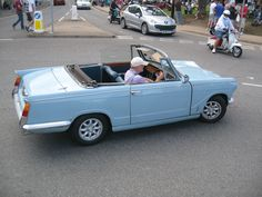 Triumph Herald Convertible.  Mine had left steering wheel and usually did not run.