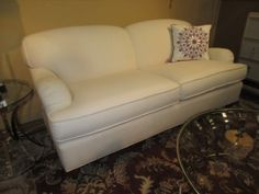 """Price: $1299.99 Item #: 40112 This English arm sofa with tight back and delicately reeded feet is by Milling Road by Baker Furniture. reminiscent of sofas found in a london townhouse, this is a classic with just enough nuance to delight but never distract, 74""""long x 38'deep x 34'high."""