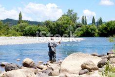 Fisherman on the Motueka River, Tasman, NZ Royalty Free Stock Photo