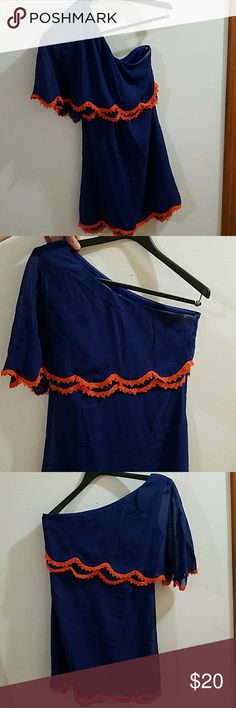 NWT Alma Mater Size S Women's One Shoulder Dress Alma Mater Size S Women's One Shoulder Dress.  Gorgeous dress! Orange and Royal Blue with wing cut on one shoulder. It has a double ruffle look to sleeve and bottom hem. Is fully lined other than sleeve. Alma Mater Dresses