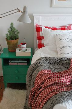 This room looks so cozy. I don't have a lot of red in my house but maybe I could add a little something like this to my guest room for the winter. I already have the white and aqua going on. Maybe I could incorporate the gray and red :)