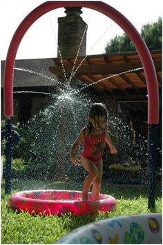 "DIY Backyard Sprinkler Park | Not just this picture! Check it out for ""dueling noodles,"" ""flower shower"" and bucket dump!"