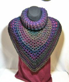 Crocheted Bandana cowl scarf fits over your head for an instant fashion statement.The colours are variegated throughout with navy blue, magenta,purple,green, teal, tan , purple and turquoise.