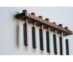 {Hickory Spice Rack} Meriwether - wood rack with cork-topped test tubes. great minimalist aesthetic