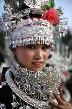 China | A girl of Miao ethnic group wearing traditional attire and exquisite silver adornments in celebrating the Sisters Festival in Taijiang County, Guizhou Province | © Qin Gang/Xinhua Press/Corbis