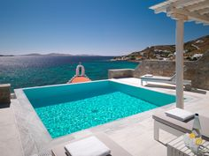 The best luxury suites in Mykonos are offered at the Mykonos Grand boutique hotel & resort. Spacious, luxurious suites accommodation with sea views & pools. Mykonos Hotels, Mykonos Greece, Hotel Suites, Hotel Spa, Luxury Suites, Hills Resort, Small Luxury Hotels, Holiday Hotel, Luxury Accommodation