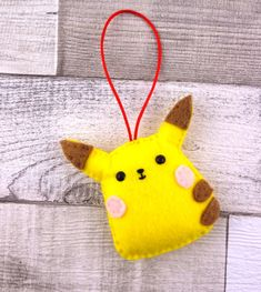Everyone needs something cute in their lives but which team will you choose? Team Pikachu or Team Totoro?! Or both! Our little felt hanging ornaments can be made with or without the Santa hat. They are around 8cm in height and come ready to hang on red satin cord.