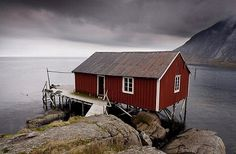 Rorbu (fisherman's hut) on stilts by fjord,Lofoten Islands,Norway,Scandinavia,Europe - Royalty Free Images, Photos and Stock Photography :: Inmagine