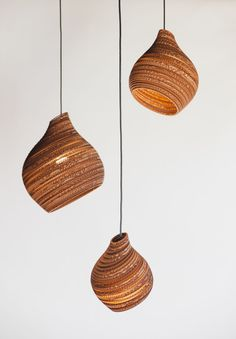 This unique recycled cardboard Hive pendant light is handmade entirely from recycled cardboard boxes, impressive isn't it? Not only are they good for the environment each one is handmade, making every Hive pendant slightly different, therefore uni. Natural Floor Lamps, Natural Table Lamps, Lamp Design, Lighting Design, Modern Light Fittings, Laser Cut Lamps, Cardboard Design, White Pendant Light, Cardboard Furniture
