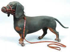 Composition Dachshund Pull Toy with small metal wh