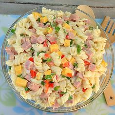 A simple, yet popular, delicious Ham and Cheese Pasta Salad with just enough dressing to make it tasty enough for seconds (or thirds ! )