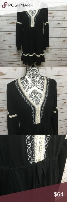 Michael Kors Black Tunic Dress Size L (large) black v-neck, drawstring waist, long sleeve caftan/Tunic boho styled dress with a beautiful cream colored embroidered design and cascading-like ribbon around the neck, sleeves, and near the hem. See pics for design detail. 55% cotton 45% modal. Made in India. Hand wash cold. Dress is in excellent condition. MICHAEL Michael Kors Dresses Long Sleeve