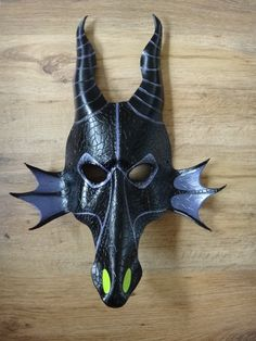 Maleficent the Dragon leather mask by Masktastic on Etsy, £60.00 I would gladly get Lasik to be able to wear this. Its so awesome!