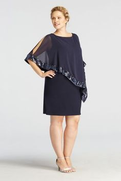 This short jersey dress with caplet overlay is a true fashion winner!  Sleeveless short jersey dress is both figure flattering and comfortable.  Chiffon caplet overlay with sequin trim provides just the right amount of coverage.  Designed by Xscape.  Fully lined. Side zip. Imported polyester/spandex blend. Professional spot clean only. Also available in Missy sizes as Style XS6150.