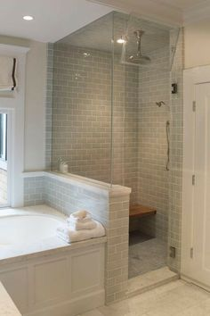Light grey tiled wall in shower / traditional bathroom / walk in shower next to bathtub