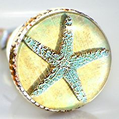 Original pretty starfish art images make these beach themed drawer and cabinet knobs a conversation starter! Add them to a special furniture piece or cabinet for a quick and easy coastal update. Sold