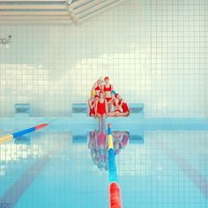 Maria Svarbova's photographs of primary coloured swimmers.