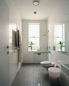 exactly what needs to be done in mom's bathroom. Tile walls and floor. glass shower surround. Tall toilet. Shallow sink. Need to figure out storage.