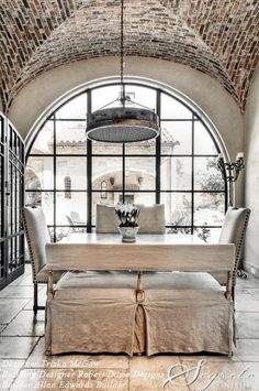 (20) Segreto Finishes.  Vaulted brick ceiling and large arched window.