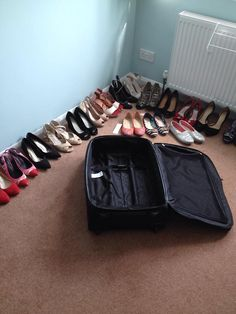 I don't think they're all going to fit not if I want to pack clothes too... #shoedilemma #RWA14 pic.twitter.com/dOMS5l09eI